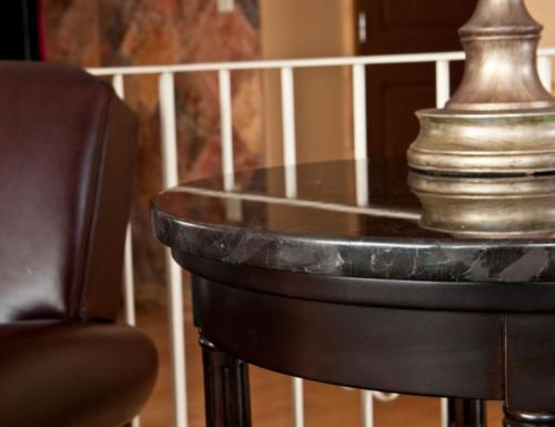 Small table with black shiny stone top. Anchorage, Alaska.